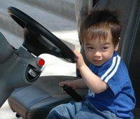Thai_boy_driving_golf_cart